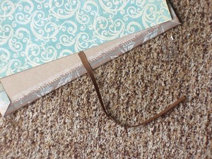 Attach the ribbon to the back of the chipboard before adding the liner paper.